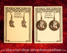 Dragon earrings - silver metal dangle charm asian chinese luck protection neverending story falkor haku spirited away quetzalcoatl serpent