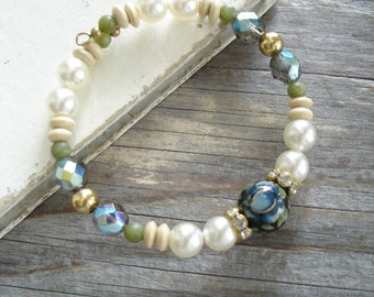 Garden Bracelet. Memory Wire Bracelet. Beaded Bangle Bracelet. Blue Rose Tensha Bead, Pearls, Crystals, Gemstones, Wood, and Golden Brass.