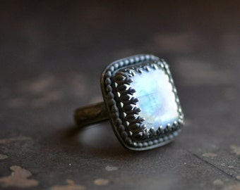 handcrafted moonstone ring set in darkened sterling silver, rectangle stone, pattern wire bezel, flower band, size 6.5