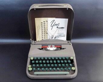 Vintage Smith Corona Skyriter Typewriter with Case and Paperwork. Circa 1940's.