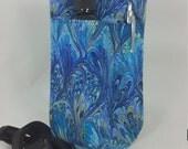 Massage Therapy Single bottle LEFT hip holster, blue oil on water print, pen pocket, black belt