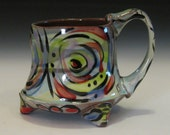multicolor circle design mug with feet whimsical fun painterly style