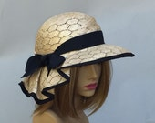 Sonya, Kentucky Derby hat,  beautiful straw hat with draped pleating on the side and trimmed in black, millinery hat