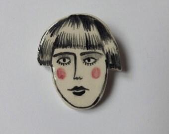 Face brooch