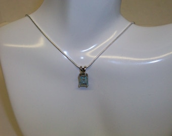 Sterling Silver necklace featuring an Emerald-cut Aquamarine