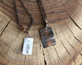 Rectangle, recycled roofing copper earrings with brass feather charm