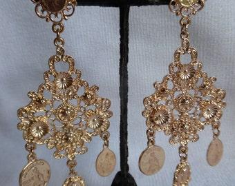 Romantic filigree and santitos chandelier earrings