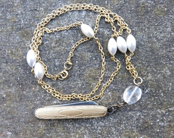 beautiful etched folding knife     on a long gold tone faux pearl chain Quartz bead