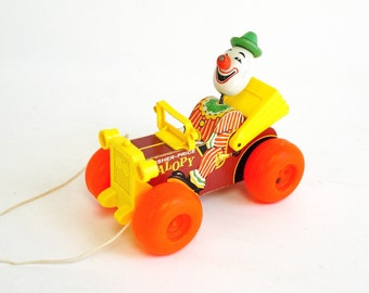 Vintage 1960s Childrens Toy / 60s Fisher Price Jalopy Clown / Pull Squeak Toy