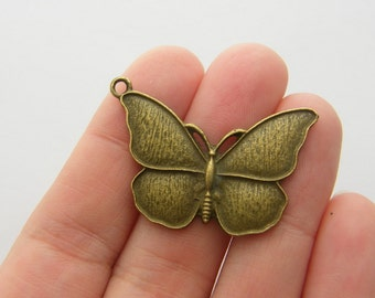 4 Butterfly charms antique bronze tone BC53