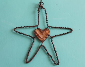 handmade rustic wire star with heart cut from vintage ceiling tile
