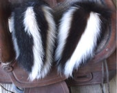 Skunk fur mittens handmade medium with red fleece liner