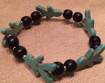 Black wooden beaded bracelet with turquoise figure beads