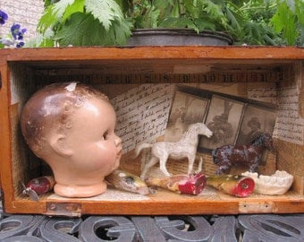 Mixed media assemblage, creepy baby head art, shadow box