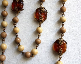 vintage long necklace / amber colored glass stones, beige and tan glass beads