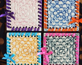 beautiful set of 4 coloured ceramic coasters lace pattern with ribbons and bows