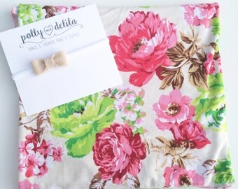Baby girl swaddle blanket and headband set. Pink flowers with a matching felt bow