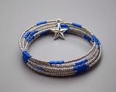 Platinum & sapphire blue beaded coil bracelet