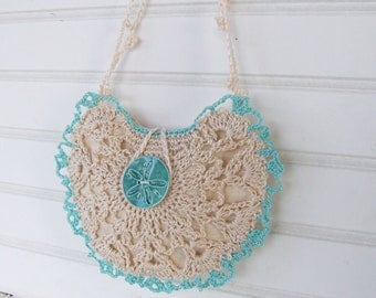 Coastal crocheted bridal purse with turquoise sand dollar button