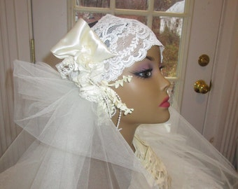 Flapper style ivory bridal headpiece and veil