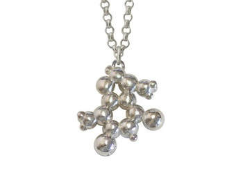 Chocolate (Theobromine) Molecule Pendant in Sterling Silver. Adjustable length.