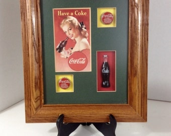 Coke Classic Coca Cola Professionally Framed Shawdow Box Featuring Cole Classic Lids, Bottle And Vintage Coca Cola Girl