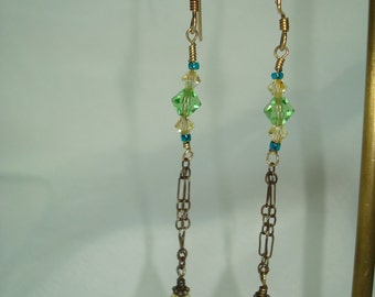 1994 Crystal Dangly Earrings and Green and Yellow.