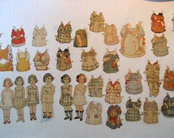 large collection of antique paper dolls