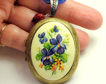 Large Cameo Locket, Vintage Purple,Blue,Orange Flower Cameo, Glass Ladybug Charm, Antiqued Gold Tone Locket,Blue Ribbon, Adjustable Necklace