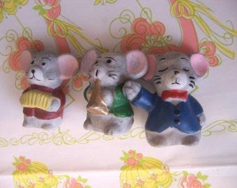 three tiny little mice figurines