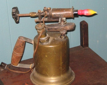 Blow torch desk lamp.
