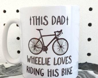 This dad wheelie loves riding his bike mug