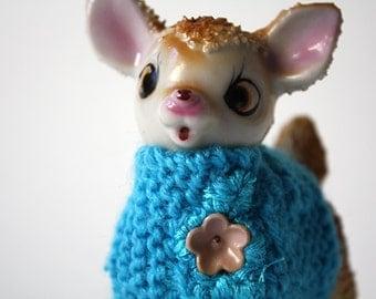 light blue sweater deer