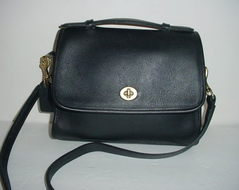 Vintage Coach black leather Cross body Court bag .