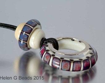 Purple, burgundy, multicolored lampwork necklace. Handmade by Helen Gorick