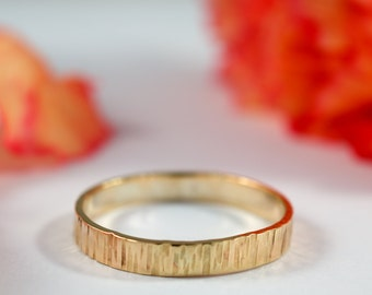 Gold Bark Wedding Band: A hers and hers pair of 9ct yellow gold textured wedding bands