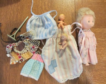 Betsy Clark 6 in. vinyl doll with clothing lot, vinyl babies, rake, apron for larger doll, Knickerbocker