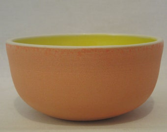 matte orange and shiny yellow ceramic bowl