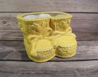 Yellow baby shoe planter