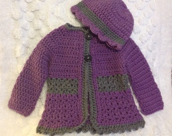 Handmade crochet sweater hat set in purple and grey accented with a flower