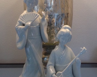 Two blanc de chine style geisha statues