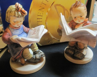 Hummels... Boy and Girl Reading the Newspaper... 184 and 418.... made in Germany