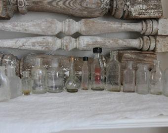 Set of 13 vintage clear glass bottles
