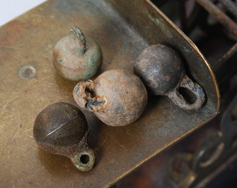 Set of 4 Antique  metal charms, bell buttons, dark patina