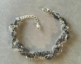 Black, silver and rhinestone chains Braided adjustable bracelet.
