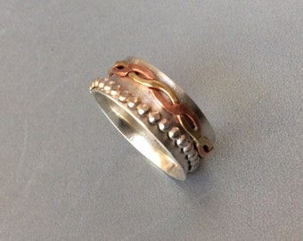 Sterling silver spinner ring with copper and brass spinner