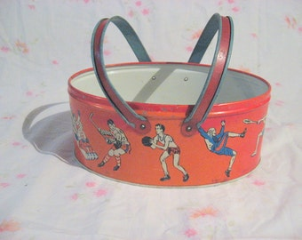 Vintage Ohio Art Co., two handled basket with sports scenes  missing lid