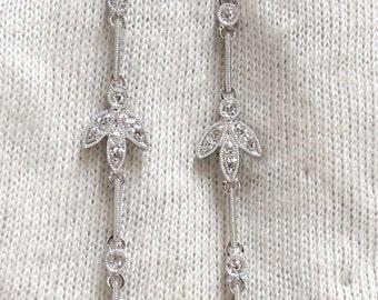 0.33ct 2.5 inch long crescent petal dangle earrings 14kt