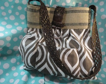 handbag, purse, market bag , brown printed design with black striped Natural Jute Webbing and braided brown belt handle with burlap flower