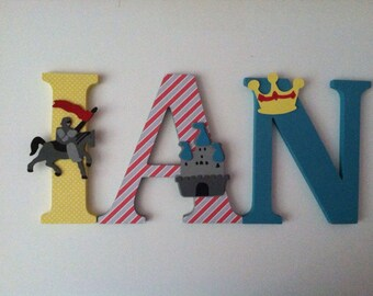 Knight themed wooden  wall letters in yellow, blue and red